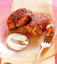 Salmon Cakes with Creamy Ginger-Sesame Sauce - Your morning staple is actually a great way to cut calories at dinner. Try these recipes that use plain yogurt to slash half the fat of your meal.