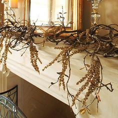 I love the whimsical look of this branch-filled garland. It'd be perfect on your fireplace mantel all throughout the season or even along a runner on your table.