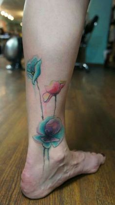 Gorgeous watercolor tattoo flowers by Tarah at Two Birds Tattoo in Seattle.