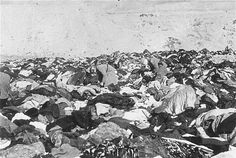 Nazis sift through the enormous pile of clothing left behind by the victims of the massacre.The History Place - Holocaust Timeline: Massacre at Babi Yar Jewish History, World History, World War Ii, Torah, Religion, Interesting History, Persecution, Historical Photos, Wwii