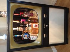 Vintage TV repurposed into a very cool Liquor Cabinet .