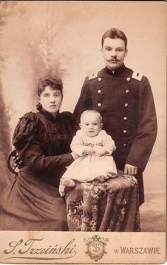 """This cabinet card features a Polish military officer posing with his wife and smiling baby at the studio of S. Trzcinski in Warsaw, Poland.""   **Something about them captivated me.  --Meggie by flora"