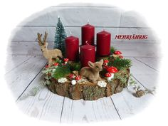 Advent wreath - Advent wreath / Advent arrangement on wooden disc - a designer piece . Christmas Swags, Xmas Wreaths, Modern Christmas, Diy Christmas Ornaments, Christmas Home, Holiday Crafts, Christmas Holidays, Holiday Decor, Christmas Centerpieces
