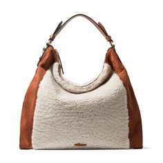 Our ANA Hobo handbag is a unique take on the classic hobo. Crafted in Italy from soft natural shearling and dark tan suede, it features the light gold JC emblem and the leather handle fits over the shoulder while still providing a comfortable fit under the arm. With a slouchy shape and spacious interior, it's the perfect everyday option. Jimmy Choo, Hobo Handbags, Handbags On Sale, Luxury Bags, Luxury Handbags, Womens Designer Bags, Dark Tan, Leather Handle, Blue And Silver
