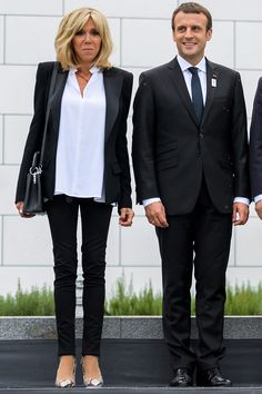 Brigitte Macron suits up in a French way pairing an Alexandre Vauthier tuxedo jacket with a white blouse and trousers while in Switzerland.