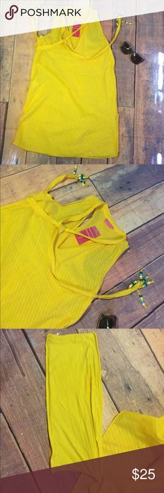 BCBGGirls Band Yellow Tunic Top Sz XS New with tag perfect for summer BCBG Girls tunic top. The top is stitched with silver thread on a bright yellow fabric. The fabric is lightly sheer but has a yellow band on the inside to wear as a tube top underneath. Defect: one of the threads that attaches the band to the top is detached, but it does not affect wearability.            Measurements approximate: top/bust 17.5 flat, length 31.5 flat BCBGirls Swim Coverups