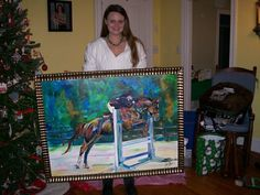 Jennifer with her new painting! Such a pretty girl! I look forward to seeing her great photography???? Maybe another cool horse painting in the future for me :)