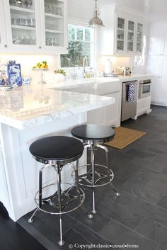 Slate floor, white counters + cabinets, lighting