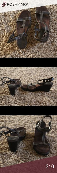 Brown t-strap wedge sandals Chocolate brown t-strap wedge sandals.  Comfy suede bottoms. Merona Shoes Wedges