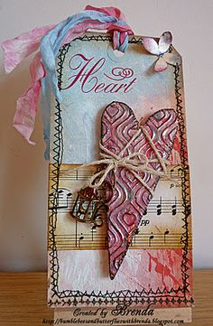 Pretty tag.  Nice colour choices which work well together.  Love the careful choices of colours of 'ribbon' (seam binding).