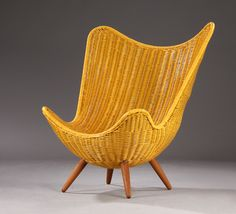 Knud Vinther; Cane, Teak and Steel Frame Lounge Chair, 2010s.