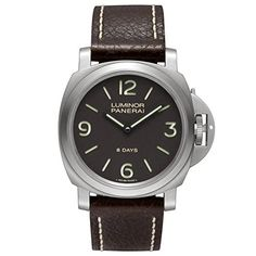 Titanium case with a brown leather strap. Fixed titanium bezel. Brown dial with black hands and index and Arabic numeral hour markers. Arabic numerals mark the quarter hour positions. Dial Type: Analo...