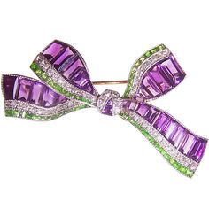 Suffragette bow brooch  England  Circa 1905  Set with callibré cut amethysts, demantoid garnets and diamonds.