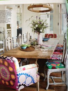 We love the colorful, playful mix of chair styles and suzani prints; the suzani adds a unifying element.