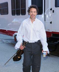 "Sherlock Holmes and his violin (Robert Downey Jr. on location for ""Sherlock Holmes,"" 2009)"