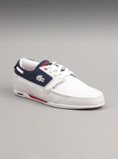 Lacoste Men Dreyfus Shoes in White/Red Perfectly chic and fit for most any  Leather upper.  Front Lace-Up closure.  Signature Lacoste croc embroidery on side.  Moc stitching at toe.  Textile lining and insole.  Rubber sole with brand detail.