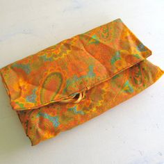 orange paisley and velvet jewelry pouch by JennyandPearl on Etsy, $18.00