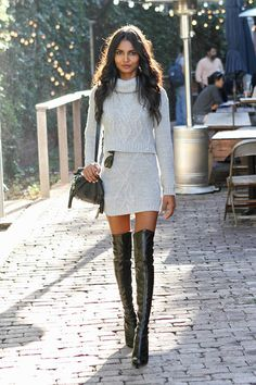 Very well put together , cable knit twin set , thigh high boots and subtle make up