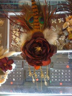 Hair Facinator: Cinnamon colored rose with puffs of fur, feathers, chairs and beads.  BlackxIris on Esty