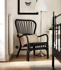 Reading corner with STORSELE black rattan armchair
