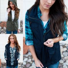 "Utility vests are the perfect way to layer this fall.  Pair them with a long sleeve tee, a flannel, or your favorite dress.  The opportunities are endless!  Our lightweight vests feature button pockets, a zipper hood, and a drawstring waist.      - Sizing:    Small 0-6    Medium 6-10    Large 10-14    - Models are 5'4"" and wearing a small.    - Fits true to size    - Materials: 100% cotton 