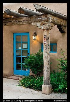 Blue door and window at house entrance. Taos, New Mexico, USA