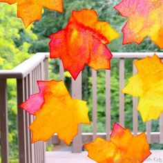How to make gorgeous and vibrant leaf suncatchers - free printable template available for download.