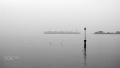 Venice In Fog - When I visited Venice, I took a tour along the islands surrounding the city. What I wasn't counting on, however, was the fog; all those little islands and buildings just seemed to fade away, as if they were a memory of Venice's rich history...