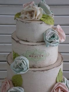 Shabby chic wedding cake....hat boxes & fabric flowers make for a cute card holder you want on display