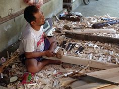 One of our fair trade carvers carving a tribal wooden mask