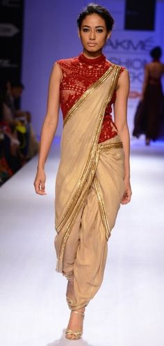 cream indowestern dhoti style saree with gold lace and red embroidered blouse