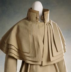 Coat, 1820s - sometimes called a Garrick or coachman's coat - love the many capes This particular garment was made for a WOMAN! INFOl View of a wool caped coat, c.1820-30 ©NTPL/Andreas von Einsiedel Description View of a wool caped coat, c.1820-30, designed for a female wearer but apparently derived from a coachman's coat. From the Snowshill Collection at Berrington Hall. -- THIS PHOTO FROM http://www.ntprints.com/image/347004/view-of-a-wool-caped-coat-c-1820-30