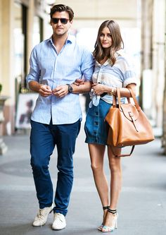 Olivia Palermo in a striped button-down, denim skirt, and ankle strap heels with a tan bag