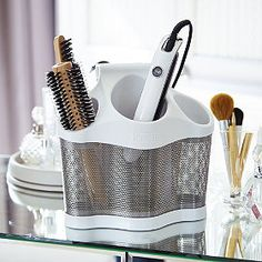 A parking system for straighteners, hairdryers and curling tongs. Cord storage pocket to rear. Freestanding or hang on hook. Hair Dryer Storage, Cord Storage, Make Up Storage, Garage Storage Solutions, Storage Ideas, Blue Granite, Stainless Steel Mesh, Stone Countertops, Towel Rail