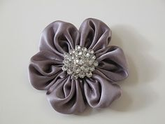 tutorial for how to make fabric flowers from old neckties and buttons