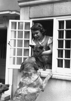 Princess Elizabeth with corgi at window. Love this picture for Princess Elizabeth (Queen Elizabeth II) with Corgi.