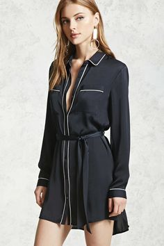 A satin shirt dress with a contrast-trimmed  basic collar, long sleeves with contrast-trimmed  button cuffs, two chest patch pockets, a removable self-tie belt sash, and button-down front with contrast piping.
