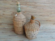 Check out this item in my Etsy shop https://www.etsy.com/listing/519364423/set-of-two-vintage-demijohn-wicker