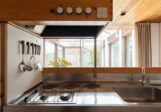 Kitchen. Mid-century modern house, South Yorkshire. Designed by Peter Aldington. Built in 1967.