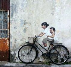 Topota Web - Tan irreal que es mentira: Impresionante pintura de unos niños en una pared