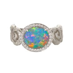 18k white gold with a 2.43 carat Lighting Ridge BLACK CRYSTAL OPAL and round brilliant-cut white diamonds.