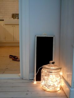 simple, clean. farmhouse sink, black counter, white cabinet. (this is what I want to see when I sit in the living room and look to the kitchen)You can do this with any large jar or vase. I have a ceramic yellow/blue jar that I put lights in by the front door.