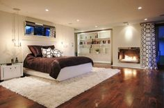 Create a cozy bedroom fireplace retreat to keep you warm on cool winter nights, with designs ranging from minimalist to rustic and traditional styles and everything in-between. Basement Master Bedroom, Basement Apartment, Cozy Bedroom, Bedroom Decor, Bedroom Rugs, Bedroom Ideas, Basement Bedrooms Ideas, Extra Bedroom, Basement House