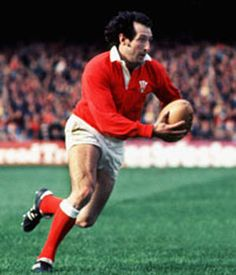 """Sir Gareth Owen Edwards, CBE (born 12 July is a Welsh former rugby union player who played scrum-half and has been described by the BBC as """"arguably the greatest player ever to don a Welsh jersey Welsh Rugby Players, International Rugby, Wales Rugby, British Lions, Sports Personality, All Blacks, Rugby League, Sports Stars, Cymru"""