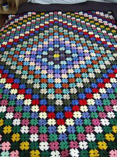Ravelry: Yo-Yo Fantasy pattern by Nancy Fuller Pattern published in the book Leisure Arts, Scrap Wraps. Crochet Afghans, Crochet Quilt, Afghan Crochet Patterns, Crochet Doilies, Crochet Stitches, Knitting Patterns, Crochet Pillow Pattern, Granny Square Crochet Pattern, Crochet Squares