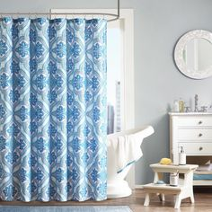 Add a pop of color to your bathroom with the Intelligent Design Lana Shower Curtain. This bright medallion design brings life to your space. Printed on microfiber this curtain is machine washable for easy care.