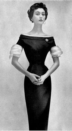 1954 Dovima modeling an Adele Simpson black dress in Harper's Bazaar