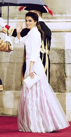 Queen Rania waved to well-wishers before entering the cathedral at the wedding of Spain's Prince Felipe and Letizia Ortiz in May 2004