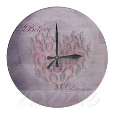 Believe and Dream Pink Butterflies Round Wall Clocks from Zazzle.com