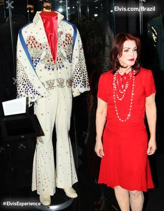 "Priscilla is standing beside the famous ""American Eagle"" jumpsuit worn by Elvis during the ""Aloha from Hawaii"" concert. 1973. There were actually 2 made. He wore the other one during the Rehearsal Concert."